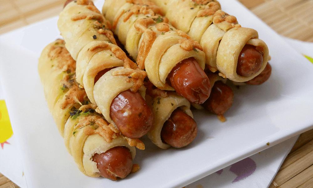 Recept | Glutenvrije bladerdeeghapjes met knakworst